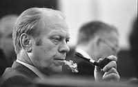 This photograph depicts President Gerald R. Ford listening during a meeting following the assassinations of Ambassador to Lebanon Francis E. Meloy, Jr. and Economic Counselor Robert O. Waring in Beirut, Lebanon. 17 June 1976