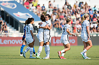 CARY, NC - SEPTEMBER 12: Sophia Smith #9 of the Portland Thorns celebrates her goal with Christine Sinclair #12 during a game between Portland Thorns FC and North Carolina Courage at WakeMed Soccer Park on September 12, 2021 in Cary, North Carolina.