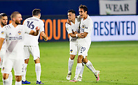 CARSON, CA - OCTOBER 07: Ethan Zubak #29 of the Los Angeles Galaxy celebrates his goal with team mate Cristian Pavon #10 during a game between Portland Timbers and Los Angeles Galaxy at Dignity Heath Sports Park on October 07, 2020 in Carson, California.