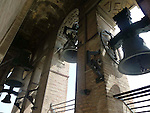 Bells in the Giralda tower at the Cathedral of Saint Mary of the See in Seville.It is the largest gothic cathedral in the world, it occupies the site of Hagia Sophia, a mosque built by the Almohads in the late 12th century. La Giralda, its bell tower, is a legacy from the Moorish structure.