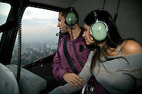 A young couple fly over Sao Paulo for 17 minutes, landing on Sofitel's helipad. They will then have a special dinner and a romantic night at the hotel. This service, called Night Air is one of the many types of helicopter use becoming increasingly popular in Sao Paulo.