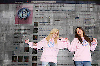 NO Repro Fee.27/10/2010.  Ballygowan Pink's B Part Of It campaign in support of Breast Cancer Awareness Month. Hundreds of UCD students got behind Ballygowan Pink's B Part Of It campaign in support of Breast Cancer Awareness Month. Pictured are  Lidia Bowles and Karen Judge from Dublin who posted messages of support to the life-sized Facebook Wall which was projected onto the entrance of UCD library. A live stream of students' messages was seen throughout the day to raise awareness of breast cancer and support the Marie Keating Foundation. Picture James Horan/Collins Photos