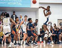 WASHINGTON, DC - NOVEMBER 16: Shawn Walker Jr. #1 of George Washington sends over a pass during a game between Morgan State University and George Washington University at The Smith Center on November 16, 2019 in Washington, DC.