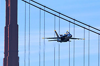 Blue Angels Lead Solo flown by  Lcdr Tyler Davies passes over the Golden Gate Bridge while approaching the airshow box.