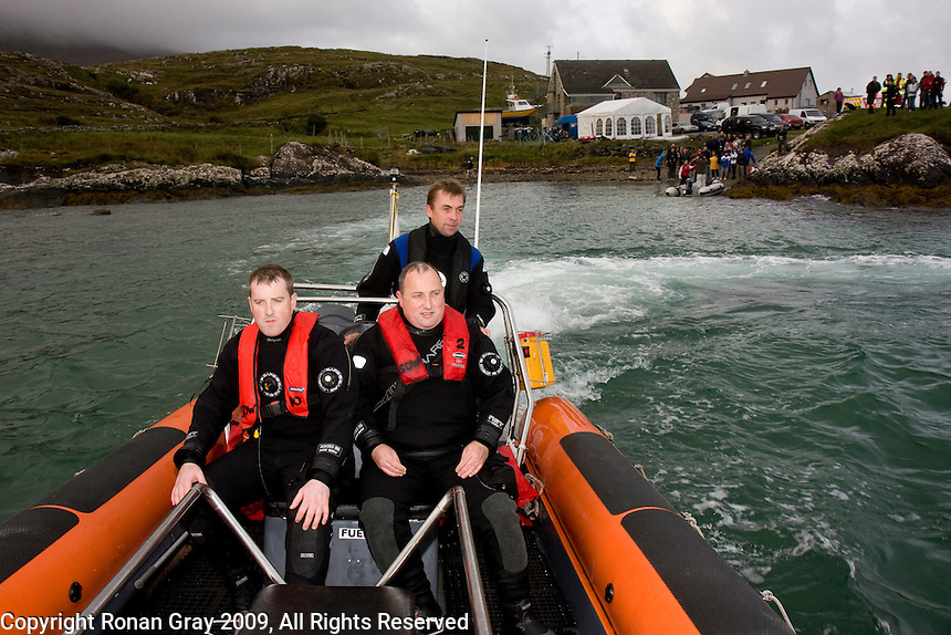 Saturday Oct 10 2009.  SCUBADIVE WEST, GALWAY, IRELAND:  Breffni Gray of SCUBADIVE West drivers brothers   Paul and Declan Devane away from the shore to begin their world record attempt to be the first divers to stay underwater on SCUBA for a period of 24-hours as well wishers look on.