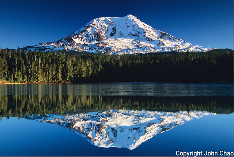Mount Adams reflected in icy Takhlakh Lake in the autumn, South Cascades Mountain Range, Washington State