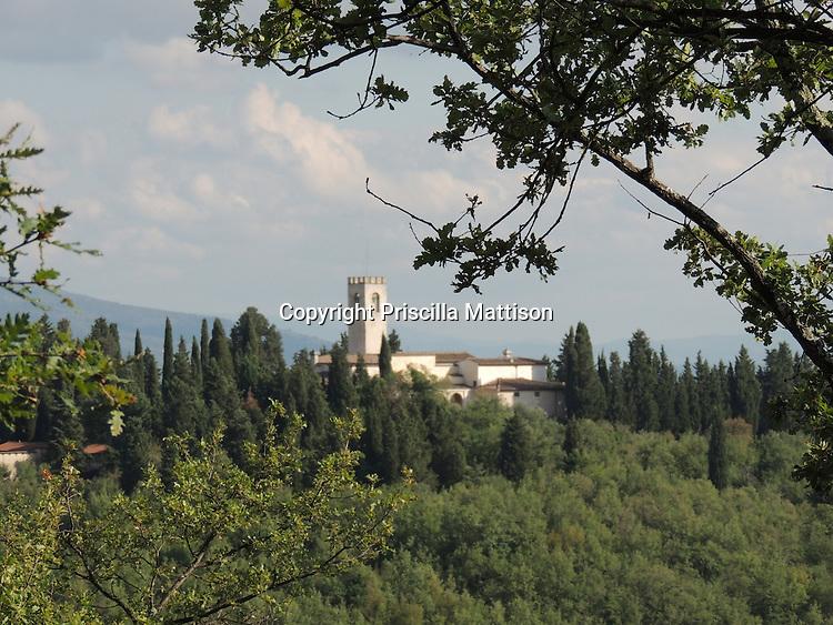 Val d'Arno, Italy - October 2, 2012:  Chiesa di San Cristoforo in Perticaia rises from a hill.