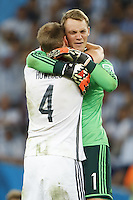 Goalkeeper Manuel Neuer of Germany celebrates with Benedikt Howedes at the final whistle