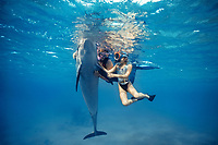 Dolphin trainer and autistic child interacting with Bottlenose Dolphin, Tursiops truncatus, Dolphin Reef, Eilat, Israel, Red Sea.