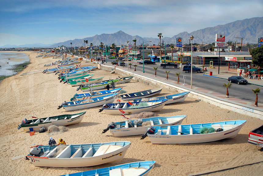 The main coastal street of San Felipe, Baja California, Mexico, with its beach full of small commercial and sport fishing vessels.