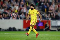 25th September 2021; Brentford Community Stadium, London, England; Premier League Football Brentford versus Liverpool; Mohamed Salah of Liverpool taking a shot