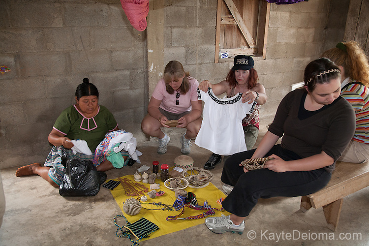 Mayan craftswoman Maria Ack displays her wares to visitors in her home in the Mayan community of San Miguel, Toledo, Belize