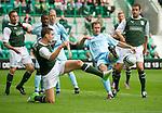 Hibs v St Johnstone...25.08.12   SPL.Paul Hanlon blocks Frazer Wright's shot.Picture by Graeme Hart..Copyright Perthshire Picture Agency.Tel: 01738 623350  Mobile: 07990 594431