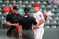 Starting pitcher Brandon Walter (37) of the Greenville Drive offers his hat, glove and belt for inspection of sticky substances by umpires Dylan Bradley and Joe Belangia in a game against the Rome Braves on Tuesday, August 3, 2021, at Fluor Field at the West End in Greenville, South Carolina. (Tom Priddy/Four Seam Images)