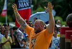 HAINAN ISLAND, CHINA - AUGUST 24:  Hafthor Bjornsson of Iceland competes at the Atlas Stones event during the World's Strongest Man competition at Yalong Bay Cultural Square on August 24, 2013 in Hainan Island, China.  Photo by Victor Fraile