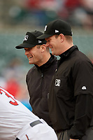 Umpires Blake Carnahan and Adam Beck during the lineup exchange before an International League game between the Buffalo Bisons and Rochester Red Wings on May 31, 2019 at Frontier Field in Rochester, New York.  Rochester defeated Buffalo 5-4 in ten innings.  (Mike Janes/Four Seam Images)