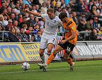 11th September 2021; Swansea.com Stadium, Swansea, Wales; EFL Championship football, Swansea versus Hull City; Ryan Bennett of Swansea City is tackled by Ryan Longman of Hull City