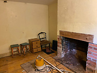 BNPS.co.uk (01202 558833)<br /> Pic: Symonds&Sampson/BNPS<br /> <br /> Pictured: A room downstairs with a fireplace.<br /> <br /> An abandoned cottage that is covered by undergrowth and looks like something out of a horror film has sold for a whopping £430,000.<br /> <br /> The derelict property, called Grasshopper Cottage, had a valuation of £275,000 before it went up for sale at auction.<br /> <br /> But due to the current state of the property market where demand far outstrips supply, interest and bidding in the 150-year-old cottage took off.