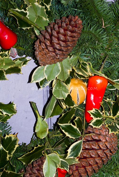 Holiday decorations wreath Christmas, pinecone, pepper, holly Ilex foliage