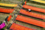 Bright threads left to dry by Avishek Das