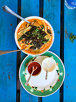 Trongsa, Bhutan.  Lunch, Noodle Soup with Dried Beef and Greens.  Red Pepper and Salt Alongside.