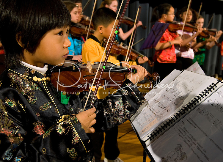 A group of Chinese heritage youth play their violin's during Chinese New Year Celebration at UNC Charlotte in Charlotte, NC.