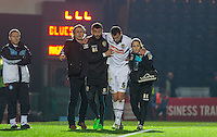 Haydn Hollis of Notts County comes off injured during the Sky Bet League 2 match between Wycombe Wanderers and Notts County at Adams Park, High Wycombe, England on 15 December 2015. Photo by Andy Rowland.