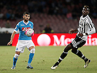 Calcio, Serie A: Napoli vs Juventus. Napoli, stadio San Paolo, 26 settembre 2015. <br /> Napoli's Elseid Hysaj, left, in action past Juventus' Paul Pogba during the Italian Serie A football match between Napoli and Juventus at Naple's San Paolo stadium, 26 September 2015.<br /> UPDATE IMAGES PRESS/Isabella Bonotto