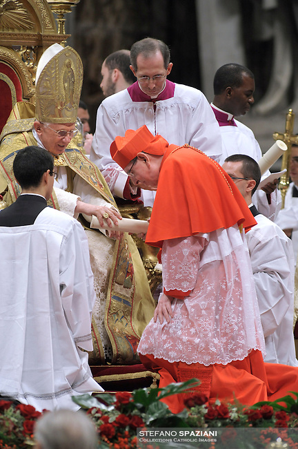 Swiss newly appointed Cardinal Kurt Koch (R) gets his biretta, the square red hat symbolising the blood of the martyrs, from Pope Benedict XVI (L) on November 20, 2010 during a consistory at St Peter's basilica at The Vatican. 24 Roman Catholic prelates join today the Vatican's College of Cardinals, the elite body that advises the pontiff and elects his successor upon his death.