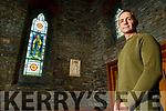 Glynn Palmer of Palmer Conservation company pictured at restored stain glass windows in St Carthage Church Brosna.