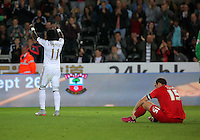 Pictured: Marvin Emnes is celebrating his goal, Keith Lowe of York City sits on the ground dejected Tuesday 25 August 2015<br /> Re: Capital One Cup, Round Two, Swansea City v York City at the Liberty Stadium, Swansea, UK.