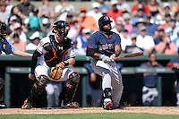 Boston Red Sox outfielder Jackie Bradley Jr. (25) at bat in front of catcher Matt Wieters (32) during a spring training game against the Baltimore Orioles on March 8, 2014 at Ed Smith Stadium in Sarasota, Florida.  Baltimore defeated Boston 7-3.  (Mike Janes/Four Seam Images)