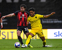 13th March 2021; Vitality Stadium, Bournemouth, Dorset, England; English Football League Championship Football, Bournemouth Athletic versus Barnsley; Romal Palmer of Barnsley competes for the ball with Ben Pearson of Bournemouth