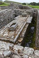 Northumberland,  England, UK.  Latrines, Housesteads Roman Fort (Vercovicium).  Water Storage Cistern Upper Left.