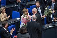 19. Sitzung des Deutschen Bundestag am Mittwoch den 14. Maerz 2018.<br /> Erster Tagesordnungspunkt war die Wahl von Angela Merkel zur Bundeskanzlerin.<br /> Im Bild: Angela Merkel ist mit 364 von 692 abgegebenen Stimmen zum vierten Mal zur Bundeskanzlerin gewaehlt worden. Der Fraktionsvorsitzender der CDU/CSU-Fraktion Volker Kauder uebergibt Angela Merkel einen Blumenstrauss.<br /> 14.3.2018, Berlin<br /> Copyright: Christian-Ditsch.de<br /> [Inhaltsveraendernde Manipulation des Fotos nur nach ausdruecklicher Genehmigung des Fotografen. Vereinbarungen ueber Abtretung von Persoenlichkeitsrechten/Model Release der abgebildeten Person/Personen liegen nicht vor. NO MODEL RELEASE! Nur fuer Redaktionelle Zwecke. Don't publish without copyright Christian-Ditsch.de, Veroeffentlichung nur mit Fotografennennung, sowie gegen Honorar, MwSt. und Beleg. Konto: I N G - D i B a, IBAN DE58500105175400192269, BIC INGDDEFFXXX, Kontakt: post@christian-ditsch.de<br /> Bei der Bearbeitung der Dateiinformationen darf die Urheberkennzeichnung in den EXIF- und  IPTC-Daten nicht entfernt werden, diese sind in digitalen Medien nach §95c UrhG rechtlich geschuetzt. Der Urhebervermerk wird gemaess §13 UrhG verlangt.]