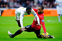 Sunday, 23 November 2012<br /> <br /> Pictured: Nathan Dyer of Swansea City falls over Patrice Evra (vice-captain) of Manchester United<br /> <br /> Re: Barclays Premier League, Swansea City FC v Manchester United at the Liberty Stadium, south Wales.