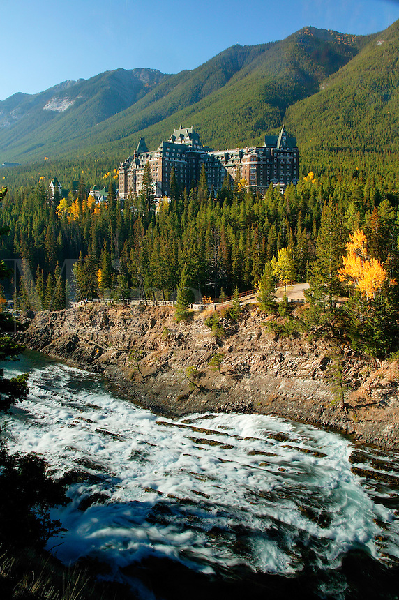Banff Springs Hotel and the Bow River at the Bow Falls, Banff, Banff National Park, Alberta, Canada.