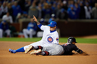 Chicago Cubs second baseman Javier Baez (9) tags Francisco Lindor (12) out attempting to steal second in the sixth inning during Game 5 of the Major League Baseball World Series against the Cleveland Indians on October 30, 2016 at Wrigley Field in Chicago, Illinois.  (Mike Janes/Four Seam Images)