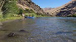 Rafters stop at a beach on the lower Deschutes River.