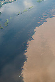 Manaus, Brazil. Aerial - meeting of the waters of the Rio Negro and the Solimoes (Amazon) - Encontro das Aguas.