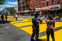 "NEW YORK, NEW YORK - June 14: People work on the ""Black Lives Matter"" mural on Fulton St in the Bedford - Stuyvesant neighborhood on June 14, 2020 in Brooklyn, NY. Protesters continue Nationwide after the death of George Floyd. (Photo by Pablo Monsalve/VIEWpress via Getty Images)"