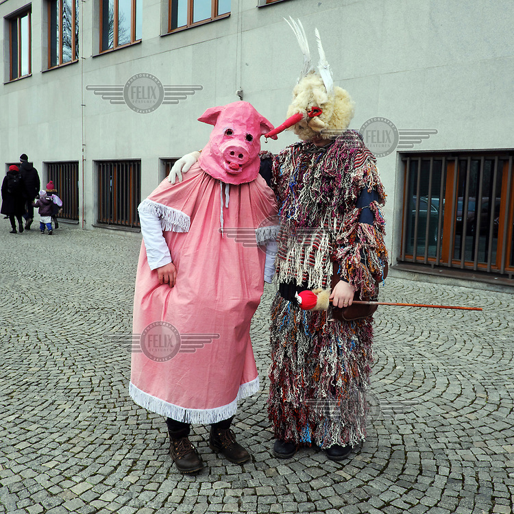 Stamen (left,12) and Theodore (13) wearing  traditional costumes at the Masopust (literally meaning 'goodbye to meat') carnival. Theodore says that his  costume represents the original Jewish symbol of fertility.