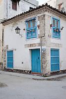 Cuba, Havana.  Old House, Old Havana.  Wooden Barrotes Cover the Ground-floor Windows.