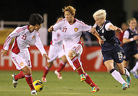 BOCA RATON, FL - DECEMBER 15, 2012: Megan Rapinoe (15) of the USA WNT challenges Li Ying (27) of China WNT during an international friendly match at FAU Stadium, in Boca Raton, Florida, on Saturday, December 15, 2012. USA won 4-1.