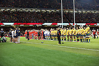 Pictured: Wales and Australia players observe a minute's silence for Remembrance Sunday. Saturday 08 November 2014<br />