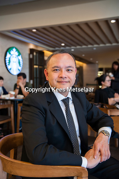Hong Kong, 24 March, 2014, Starbucks in the Alexandra House in Central Hong Kong.<br /> <br /> Mr. Patrick Kwok, head of operations of Coffee Concepts which is the licensee of Starbucks Coffee International.<br /> <br /> For story by George Russell in A Plus Magazine.<br /> <br /> Photo Kees Metselaar