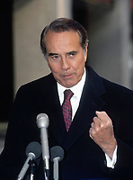"Washington, DC. USA, November 8, 1992<br /> US Senator Robert Dole speaking to reporters outside the CBS studios after appearing on the Sunday Morning talkshow  ""Face The Nation"" <br /> CAP/MPI/MRN<br /> ©MRNJ/MPI/Capital Pictures"