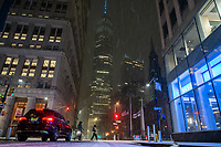 NEW YORK, NEW YORK - JANUARY 31: People walk around One World Trade Center during the pass of the snowstorm on January 31, 2021 in New York City. New York City Mayor Bill de Blasio declared a state of emergency order due to the arriving storm that's expected to wallop New York, where airports are expected to cancel the majority if their flights. (Photo by Eduardo MunozAlvarez/VIEWpress)