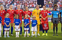 CHARLOTTE, NC - OCTOBER 3: Ashlyn Harris #18 stands with Ali Krieger #11 of the United States during a game between Korea Republic and USWNT at Bank of America Stadium on October 3, 2019 in Charlotte, North Carolina.