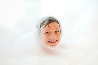 Boy taking bubble bath.